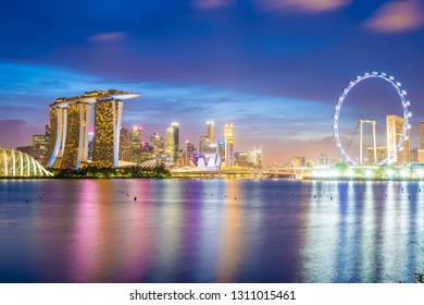 Beautiful architecture building skyscraper around marina bay in singapore city at twilight