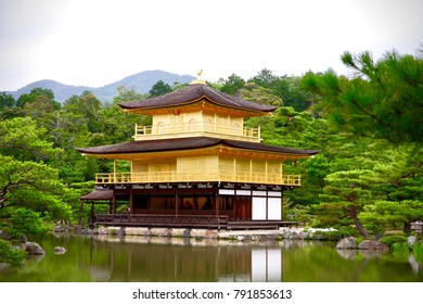 """The beautiful architecture of Kinkaku-ji ( or called """"Golden Pavilion Temple"""" in English ) and the Japanese zen garden at Kyoto, Japan. Historic Monuments of Ancient Kyoto. Unesco World Heritage Site."""