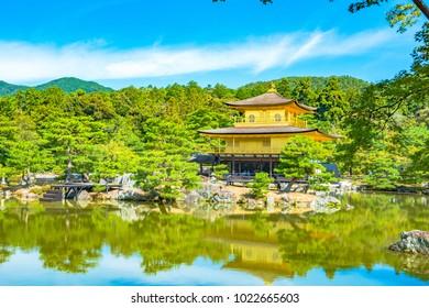 Beautiful architecture at Kinkaku-ji (Temple of the Golden Pavilion), officially named Rokuon-ji (Deer Garden Temple), a Zen Buddhist temple in Kyoto, Japan. Kinkakuji Temple under blue cloudy sky day