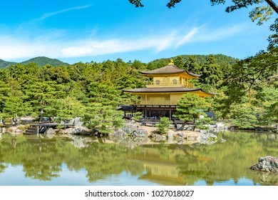 Beautiful architecture at Kinkaku-ji (Temple of the Golden Pavilion), officially named Rokuon-ji (Deer Garden Temple), a Zen Buddhist temple in Kyoto, Japan. Kinkakuji Temple under blue cloudy sky day