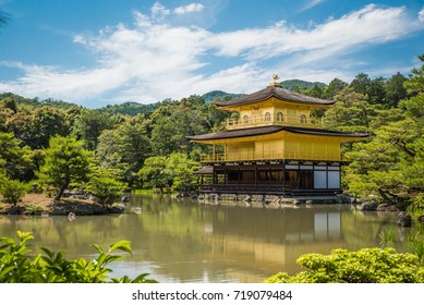 Beautiful Architecture at Kinkakuji Temple (The Golden Pavilion) against blue sky in Kyoto, Japan.