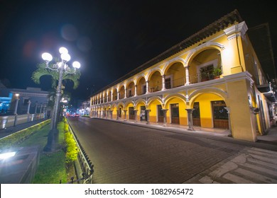 beautiful architecture of the old houses decorated with stone arches of the center of Cordoba in Veracruz with warm lighting at night