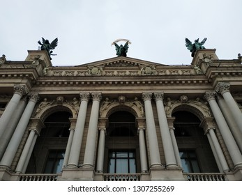 Beautiful architecture of the theater building in the old city of Lviv. Stone columns and statues at the main entrance to the Lviv landmark