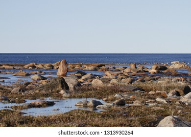 Beautiful arctic landscape in summer colours with blue skies and soft clouds, Arviat, Nunavut Canada