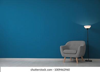 Beautiful Armchair And Floor Lamp Near Color Wall