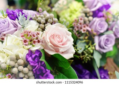 Beautiful arrangement of wedding bouquets, with focus on light pink rose.