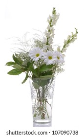 A Beautiful Arrangement of White Flowers in a Crystal Vase on White
