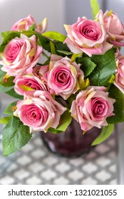 Beautiful artificial bouquet of roses in vase