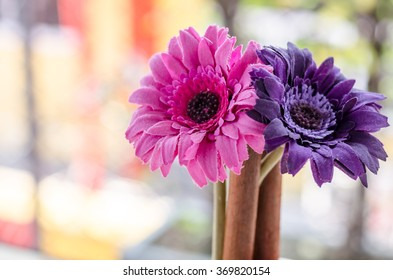 Beautiful artificial flowers on wooden and nature background