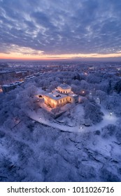 Beautiful artistic aerial view of the old observatory building on top of Vartiovuori hill at winter sunrise. The observatory was designed by Johan Carl Ludvig Engel in 1810. Turku, Finland