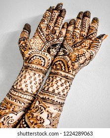 Beautiful artwork of Henna Mehndi on fair hands of young Indian girl. Mehndi, Henna dye is applied on girl's hand during Indian festival of karvachauth, makar sankrati etc. and during their marriage