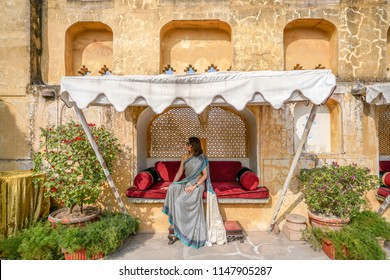 Beautiful Asia girl wearing Traditional India Dress ( Sali ) on the Palace, Jaipur, Rajasthan - India