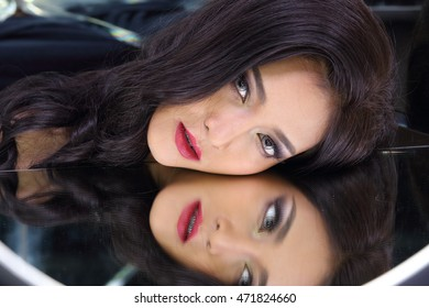 Beautiful Asia Thai Female Model with Fashion Make Up Red Lip and Eye shadow with studio lighting, Mirror reflect face of herself