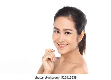 Beautiful Asia Thai woman with black hair, open shoulder and smile, face close up portrait studio on white, copy space for text