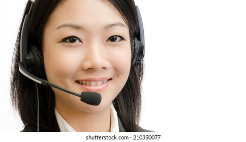 Beautiful asia young business woman with headset isolated on white background