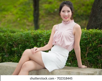 Beautiful Asia young woman in the park. Outdoor portrait.