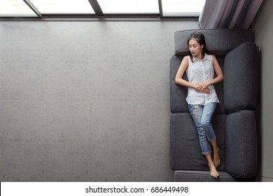 Beautiful Asia Young Woman Sleeping On Sofa, Ages 30 - 40 ,Top Bird Eye View, In Daytime , Condominium Indoor.