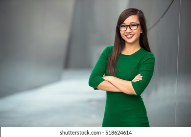 Beautiful asian architect student positive cheerful creative designer smiling with arms crossed