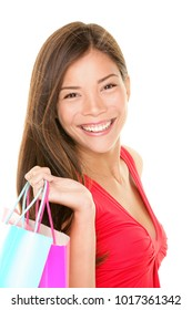 Beautiful Asian beauty woman smiling portrait holding shopping bags. Multiracial girl isolated on white background, studio cutout.