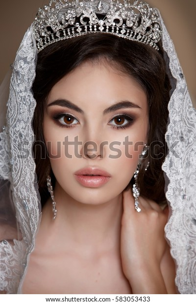 Beautiful Asian Bride with diamond jewelry Fashion portrait studio. Gorgeous young bride with wedding makeup and long dark hair in bridal lace dress isolated.