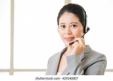 Beautiful asian business customer service woman smiling in office