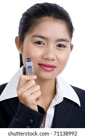 beautiful asian business woman holding an usb stick, isolated on white background