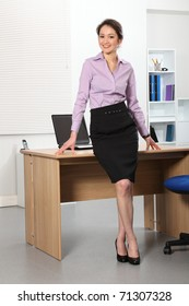 Beautiful Asian business woman standing in office