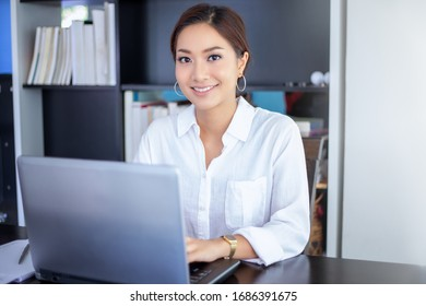 Beautiful Asian business women checking document and using notebook working from home for social distance and self responsibility concept