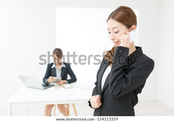 Beautiful asian business women in the office