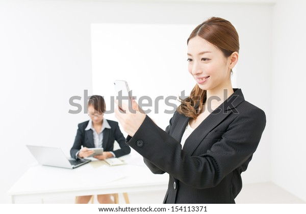 Beautiful asian business women in the office