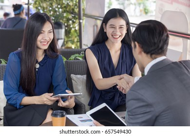 Beautiful asian businesswoman with attractive smile while success for business, business agreement concept. 20-28 year old.
