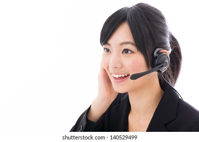 beautiful asian businesswoman with headset on white background