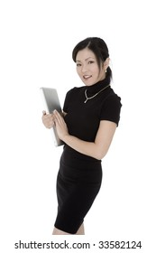 Beautiful Asian businesswoman holding a laptop computer