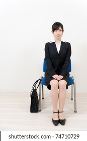 beautiful asian businesswoman sitting on the chair