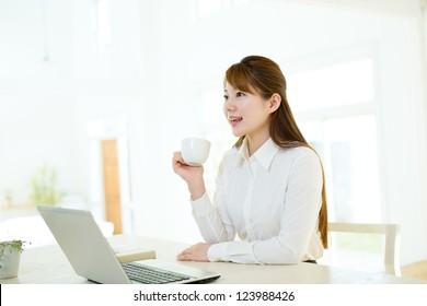Beautiful asian businesswoman using a laptop computer
