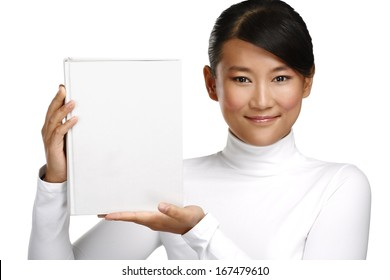 Beautiful asian chinese girl showing a blank book on white
