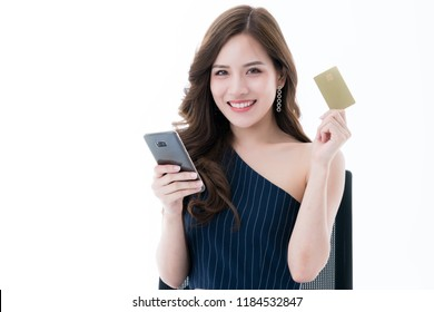 beautiful asian elegance female enjoy online shopping with credit card and smartphone business ideas concept