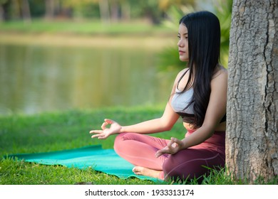 Beautiful asian fat woman play yoga at the park,Need to slim fit body