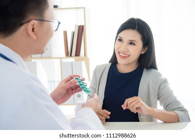 Beautiful asian female patient listening doctor explain medication in clinic