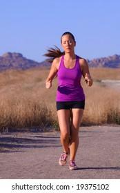 beautiful asian female runner in purple top