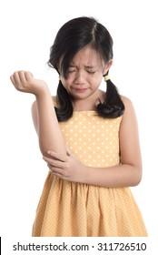 Beautiful asian girl crying on white background isolated