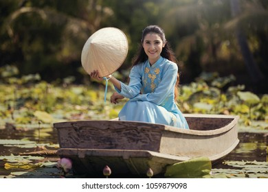 Beautiful Asian girl dressed in Vietnamese culture dress Ao Dai Dress, Vietnam
