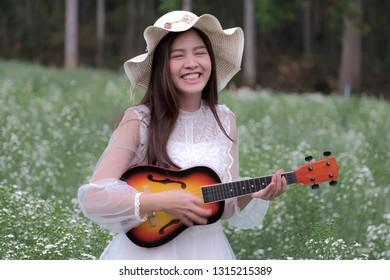 Beautiful asian girl at flower garden.