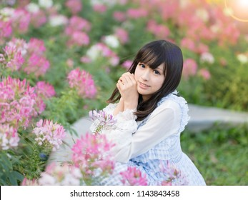Beautiful asian girl in flowers
