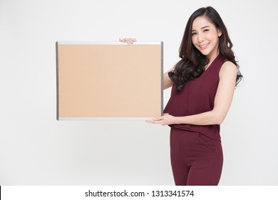 Beautiful Asian girl holding a blank poster for text or ad, Empty label for advertising or products picture