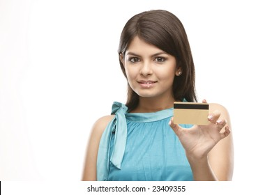 Beautiful asian girl holding a  credit card