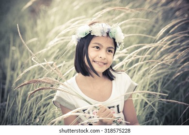 Beautiful asian girl holding glass flowers in a farm;vintage tone style