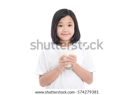 7a212a37ccb Beautiful Asian girl holding glass of milk on white background isolated