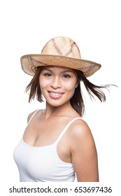 Beautiful Asian girl looking happy with a straw hat on vacation