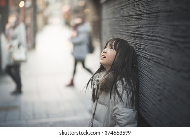 Beautiful asian girl looking up on street,Gion Kyoto Japan